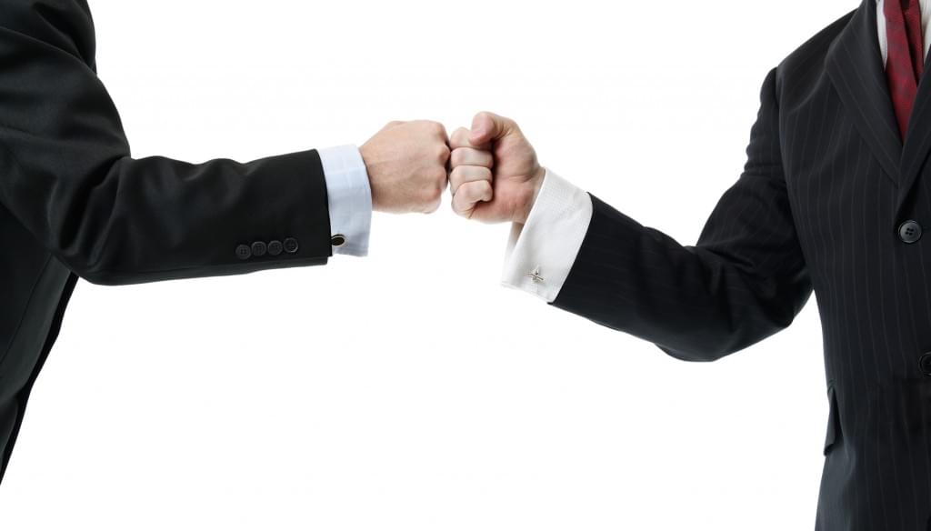 sales meeting fist bump