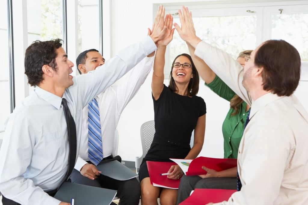 sales meeting high five