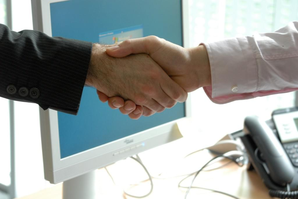 sales meeting handshake