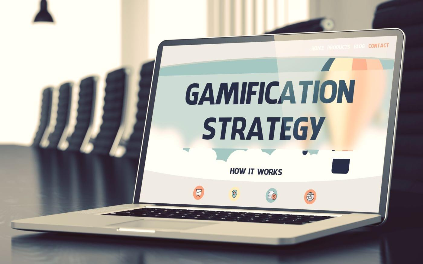 "Picture of a laptop with the words ""gamification strategy"" on the screen"