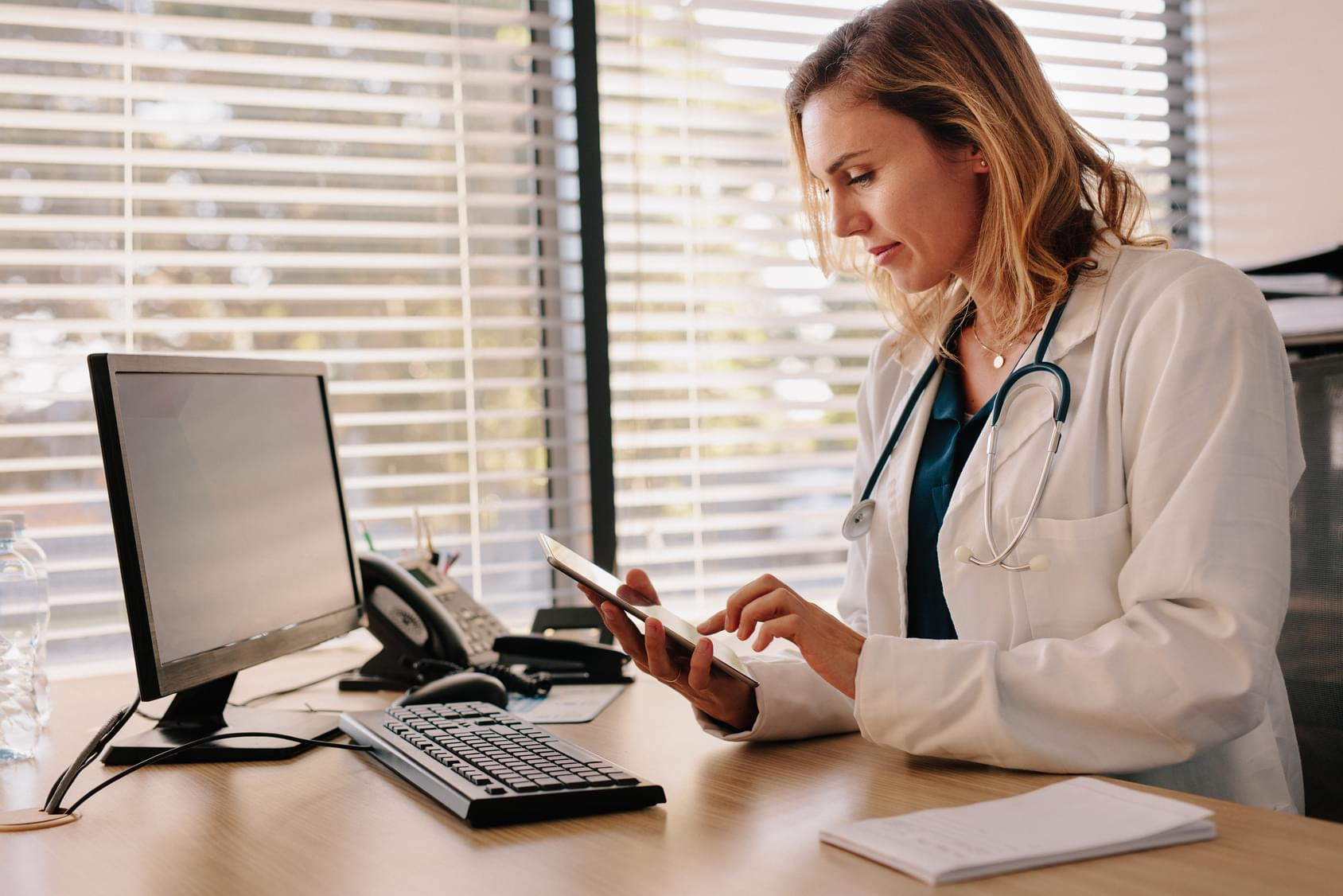 Doctor accessing an EHR from her tablet