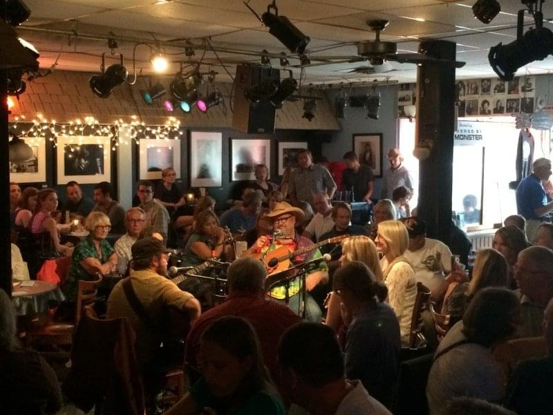 Photo of a songwriters round at The Bluebird Cafe in Nashville.