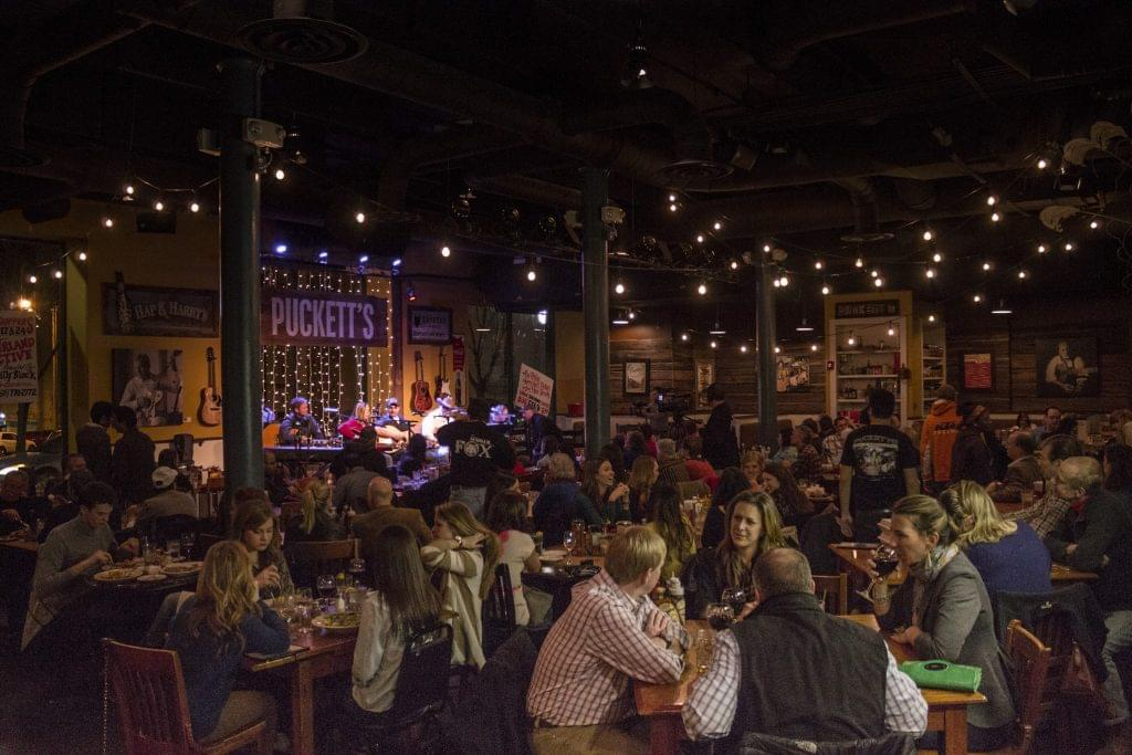 Photo of a songwriters round at Puckett's in Nashville.