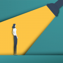 Illustration of a recruiter shining a spotlight on a female candidate.
