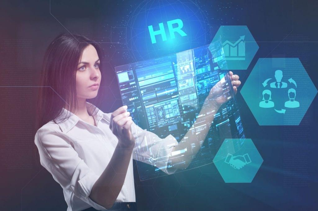 Woman looking at examples of HR software.