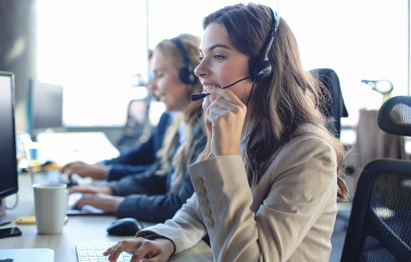 Women with phone headset doing telemarketing.