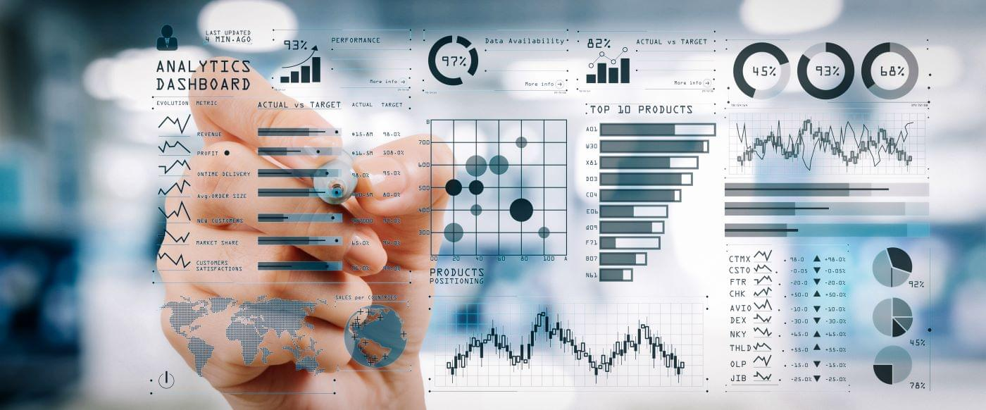 Man using business management software to analyze company metrics.