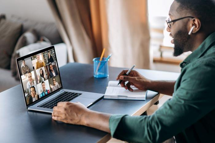 Business man using a video conferencing collaboration software to communicate internally.
