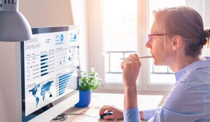 Businesswoman using web analytics tools.