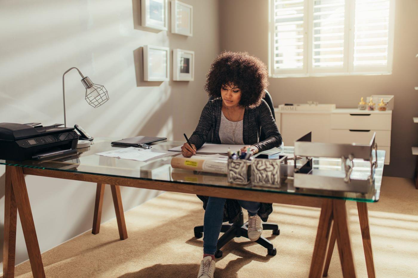Female business leader working at her desk.